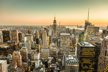 empire state building: New York City. Manhattan downtown skyline with illuminated Empire State Building and skyscrapers at dusk.