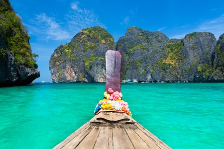 phi phi: Traditional wooden boat in a picture perfect tropical Maya bay on Koh Phi Phi Leh Island, Thailand, Asia