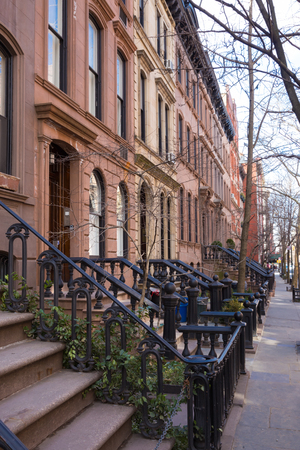 greenwich: Old houses with stairs in the historic district of West Village, Manhattan, New York. Stock Photo