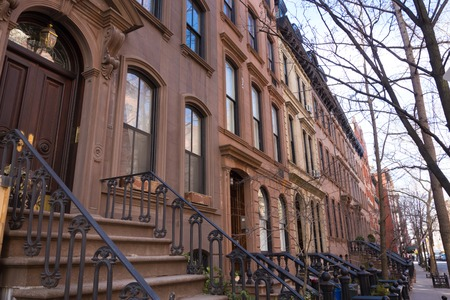village: Old houses with stairs in the historic district of West Village, Manhattan, New York. Stock Photo