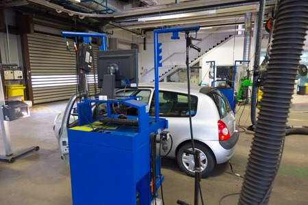 Car waiting for lights inspection and pollution measurements ontechnical review in car repair shop. 版權商用圖片