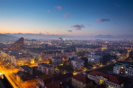 ljubljana: Cityscape of Slovenian capital Ljubljana at dusk. Alps mountains in background.