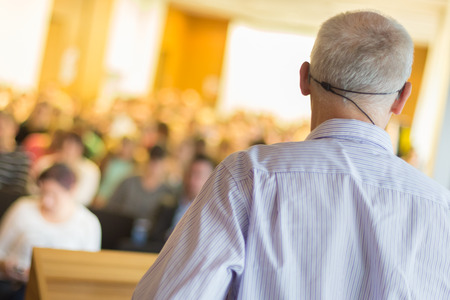speaker: Speaker at Business Conference and Presentation. Audience at the conference hall. Business and Entrepreneurship. Stock Photo