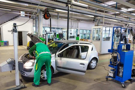 reparations: Car waiting for lights inspection and pollution measurements ontechnical review in car repair shop. Stock Photo