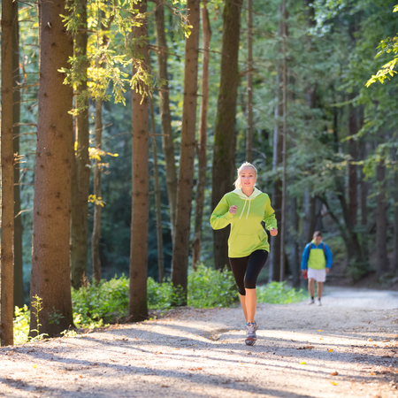 woman alone: Pretty young girl runner in the forest.  Running woman. Female Runner Jogging during Outdoor Workout in a Nature. Beautiful fit Girl. Fitness model outdoors. Weight Loss. Healthy lifestyle.