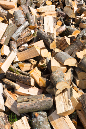firewood background: Chopped firewood on a stack. Firewood background Stock Photo