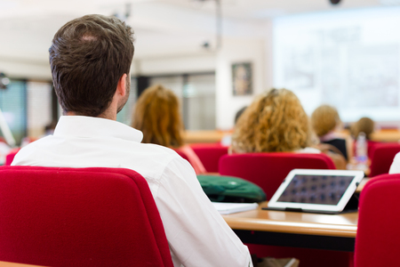 business manager: Business workshop and presentation. Audience at the conference room. Stock Photo