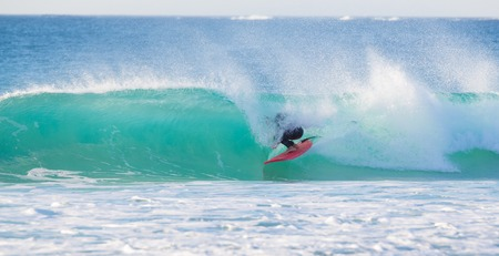 summertime: Surfer riding a perfect wave. Panoramic composition.