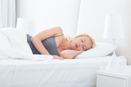 relaxing at home: Young beautiful blonde woman sleeping peacefully. Joy and happiness. Beauty sleep. Power nap.