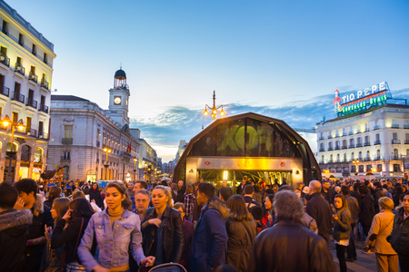 streetlife: Madrid, Spain - Jan 23, 2016:  Crowd of people visiting and  passing trough busy Puerta del Sol square at dusk on January 23th, 2016 in Madrid, Spain.