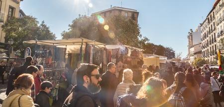 streetlife: Madrid, Spain - Jan 24, 2016:  People visiting el Rastro, sunday  flea market, on January 24th, 2016 in Madrid, Spain. El Rastro is the most popular open air flea market in Spain.