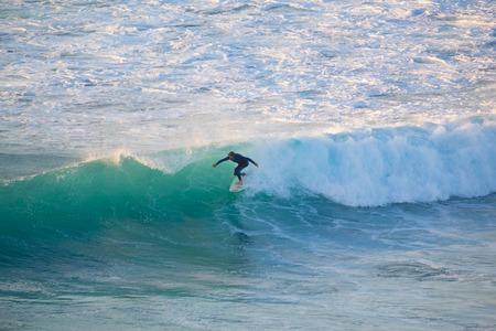 perfect waves: La Pared, Spain - Dec 23, 2015:  Active sporty senior surfer riding perfect wave on La Pared beach, famous surfing destination on Fuerteventura, Canary Islands, Spain on December 23, 2015.