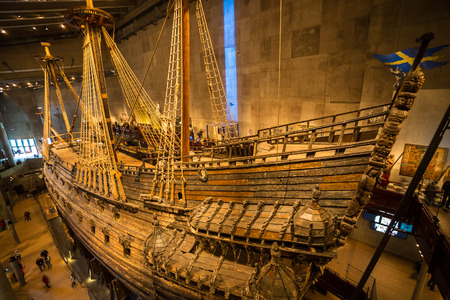 displays: Stockholm, Sweden - June 6, 2015: The Vasa Museum in Stockholm, displays the Vasa ship, fully recovered 17th century viking warship, on June 6, 2015.