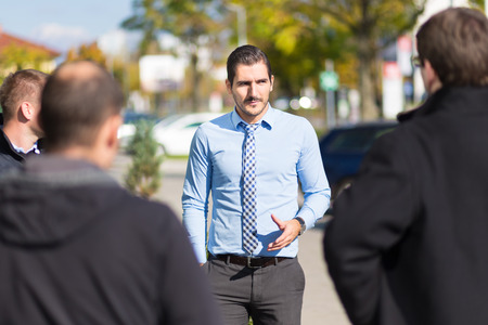 approached: Businessman being approached and blackmailed by racketeers.
