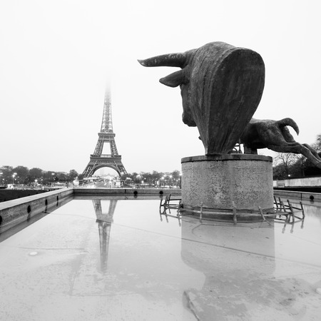 square image: Sculptures and fountains on Trocadero and Eiffel Tower in Paris, France. Black and white vintage image. Square composition.