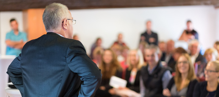 authoritative: Authoritative boss scolding his employees. People in meeting room.  Business and entrepreneurship concept. Rear view. Horisontal composition. Background blur. Stock Photo