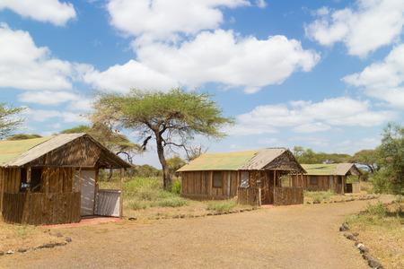 enviroment: Safari vacation. Woman enjoying natural enviroment from traditional african tourist lodge.
