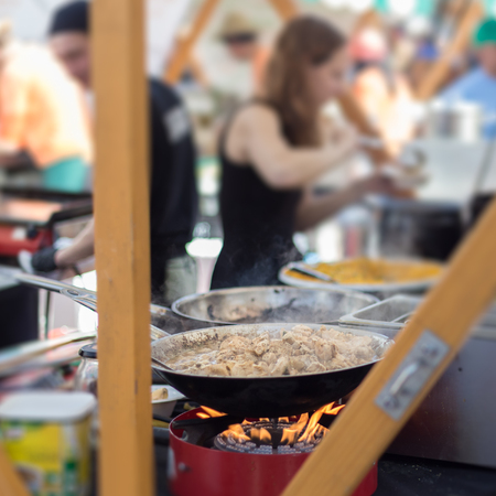 ljubljana: Cheff cooking traditional African stew on street stall on international street food festival of Odprta kuhna, Open kitchen event, in Ljubljana, Slovenia. Stock Photo