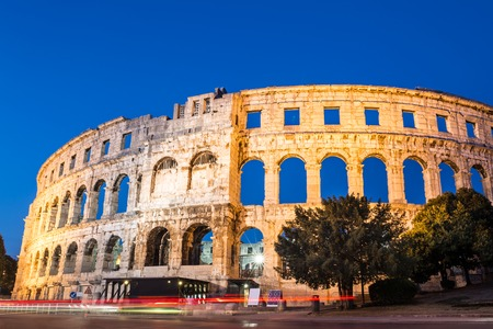 arena: The Roman Amphitheater of Pula, Croatia shot at dusk. It is among the six largest surviving Roman arenas in the World and best preserved ancient monument in Croatia. Stock Photo