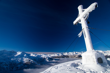 memorial cross: Cross on the top of mountain Vogel in slovenian Alps. Foto de archivo