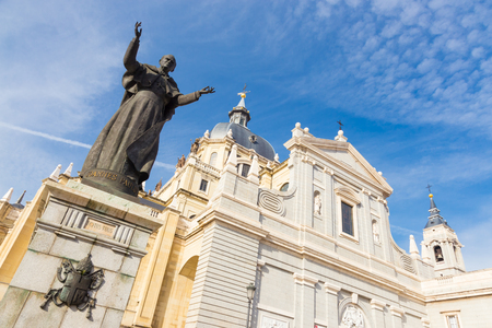 pope: Pope John Paul II statue in front of Cathedral Almudena in Madrid, Spain. Stock Photo