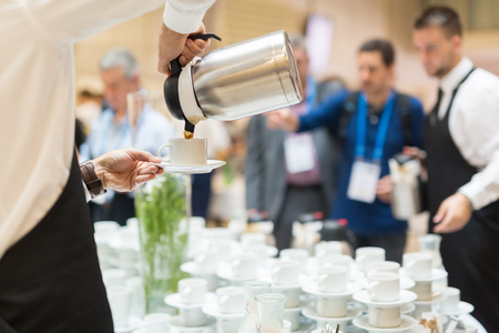 break: Coffee break at conference meeting. Business and entrepreneurship. Stock Photo