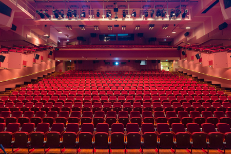 Interior of modern empty red congress hall.