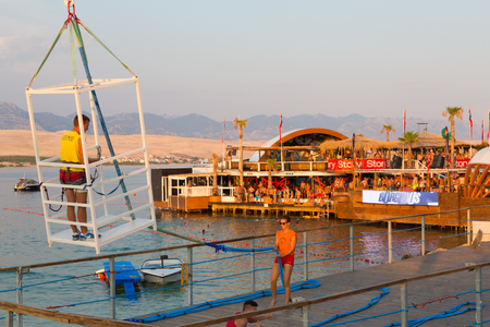 people partying: Novalja, Croatia, - July 24, 2015: Crowd of young people partying on a hot summer day on Zrce beach, Novalja, Pag island, Croatia, most popular party destination on Adriatic sea, on July 24, 2015.