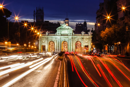 trafic: Puerta de Alcala and trafic lights shot at dusk, Madrid, Spain. Stock Photo