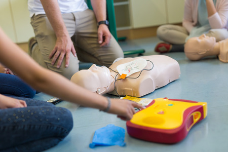 chest compression: First aid cardiopulmonary resuscitation course using automated external defibrillator device, AED.
