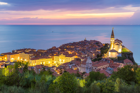 costal: Romantic colorful sunset over picturesque old costal town Piran, Slovenia. Senic panoramic view. Stock Photo