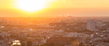 yelloow: Beautiful panoramic aerial view over Berlin, Germany, in romantic colorful sunset.