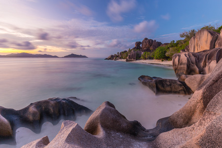 argent: Beautifully shaped granite boulders and a dramatic sunset at picture perfect tropical Anse Source dArgent beach, La Digue island, Seychelles. Stock Photo