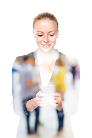 hands free phone: Beautiful young caucasian woman in business attire using smart phone application on white background. Double exposure with abstract blur of couple dating in background.