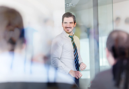 Relaxed cheerful team leader and business owner leading informal in-house business meeting. Business and entrepreneurship concept. Stockfoto