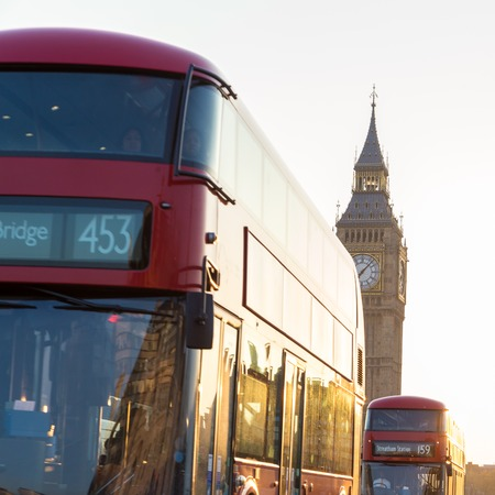 doubledecker: Traditionally red double-decker buses passing on Westminster Bridge in sunset in London, UK. Big ben and Palace of Westminster aka Houses of Parliament in background.