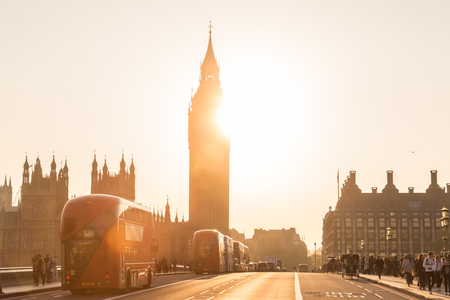 bigben: London, UK - April 7, 2015: Traffic and pedestrians passing on Westminster Bridge in sunset on 7th of April, 2017 in London. Big ben and Palace of Westminster aka Houses of Parliament in background. Editorial