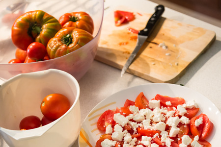 Traditional greek tomato salad with feta cheese.