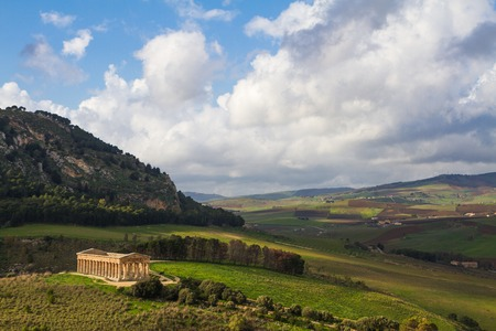 corinthian column: Dramatic landscape and ancient greek doric temple in Segesta archaeological area, Sicily, Italy.