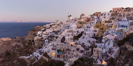World famous Oia village or Ia at sunrise, Santorini island, Greece.