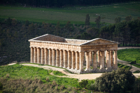 Summer landscape with ancient Greek temple of Venus, Segesta village, Sicily, Italy. Stock Photo