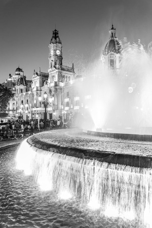 Fountain on Modernism Plaza of the City Hall of Valencia, Town hall Square, Spain. Modernisme Plaza of the City Hall of Valencia Placa del Ajuntament. Black and white vertical image. Standard-Bild