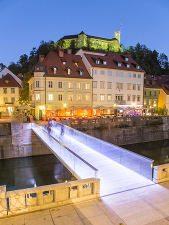 Evening panorama of Ljubljana riverfront, architecture and castle, capital of Slovenia.