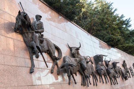 Wall statuee Run of Bulls at the Plaza de Toros de Las Ventas in front of bullring in Madrid , Spain.