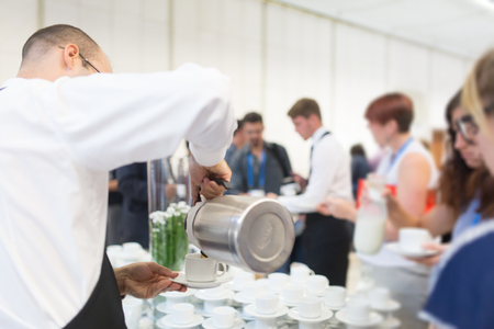 Coffee break at conference meeting. Business and entrepreneurship. Stock Photo
