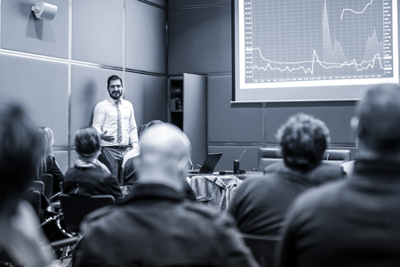 Public Speaker Giving a Talk at Business Meeting. Audience in the conference hall. Business and Entrepreneurship concept. Blue toned black and white image. Stock fotó - 98800909