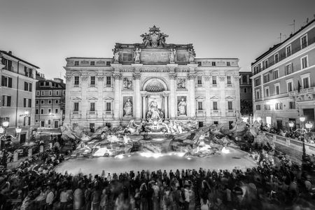 Rome Trevi Fountain or Fontana di Trevi at dusk, Rome, Italy. Trevi is the largest Baroque, most famous and visited by tourists fountain of Rome. Black and white image. Stock Photo