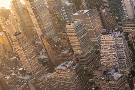 Aerial view of New York City skyline with Manhattan midtown urban skyscrapers at dramatic after the storm sunset, USA.