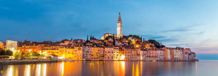 Colorful sunset of Rovinj town, Croatian fishing port on the west coast of the Istrian peninsula. Colorful evening seascape of Adriatic Sea. Traveling concept. Stock fotó