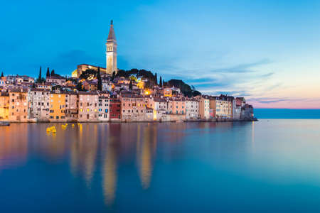 Colorful sunset of Rovinj town, Croatian fishing port on the west coast of the Istrian peninsula. Colorful evening seascape of Adriatic Sea. Traveling concept. Imagens